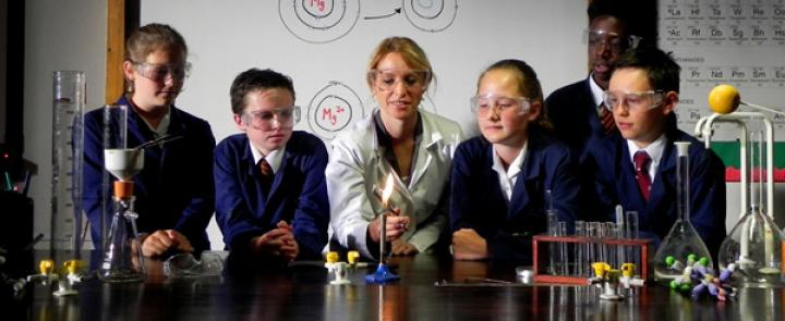 A Science teacher with her pupils at Felsted Prep | Dickinson British School Consulting