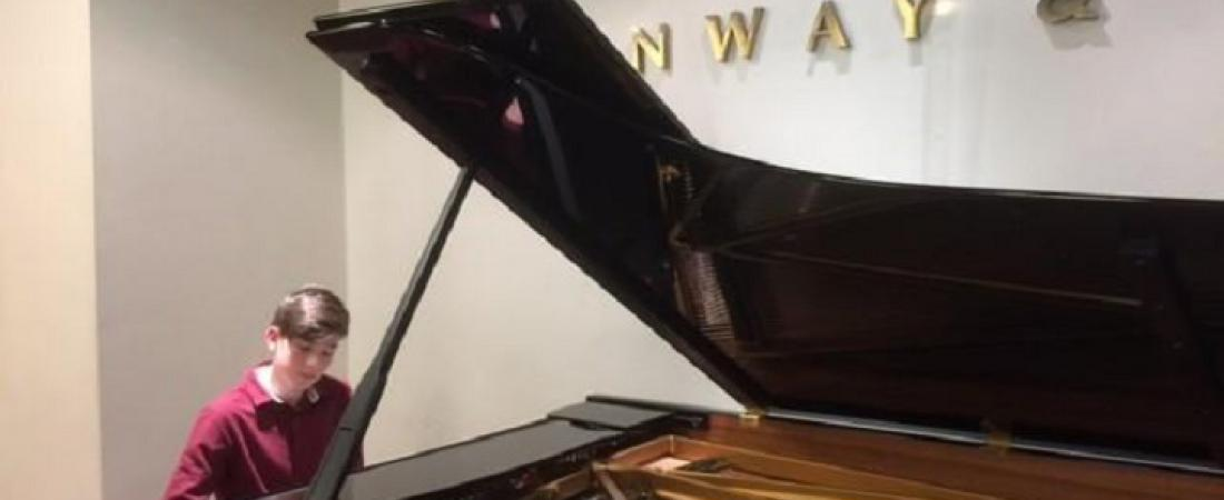Hamish Ogilvy of Scottish boarding school Loretto, demonstrating his love of music at Steinway Hall | Dickinson School Consulting Ltd.